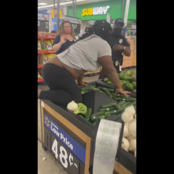 Woman On Drugs Goes Insane In Walmart And Climbs On Food!